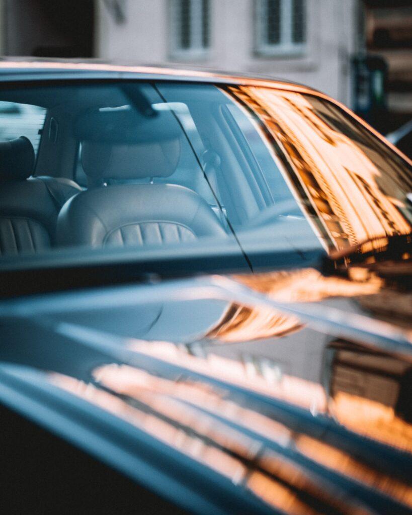Reflection on windshield of Jaguar car