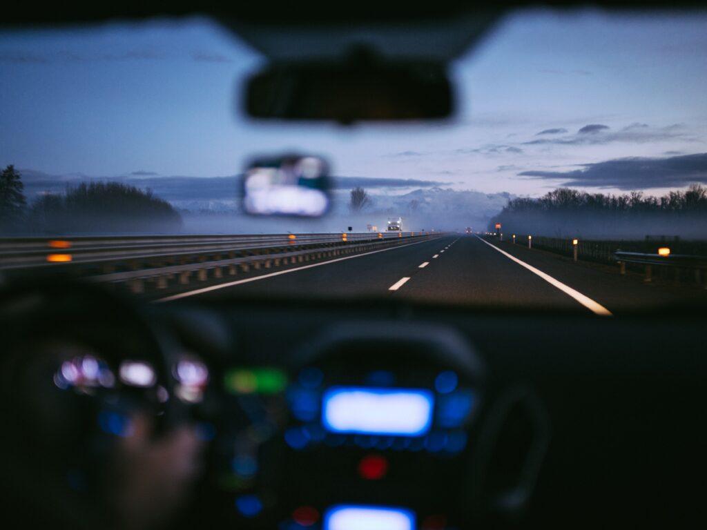 POV of someone driving toward a mountain range